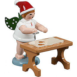 Baker Angel with Hat and Cookie Cutter at the Table  -  6,5cm / 2.5 inch